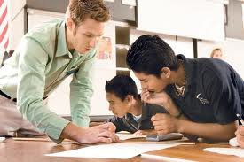 teacher and students working